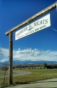Pioneer Meats sign with Crazy Mtns behind